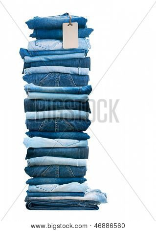 Pile of blue jeans isolated on white.