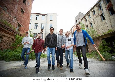 Portrait of spiteful hooligans walking down street