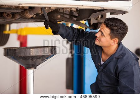Draining down old engine oil