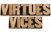 virtues and vices  - ethics concept -collage of isolated text in letterpress wood type poster