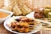 Chicken satay, ketupat or malay rice dumpling, lemang, rendang. Traditional Malay food, ramadan dish. Malaysian cuisine. poster