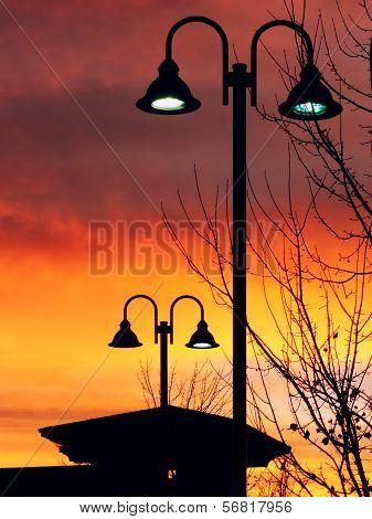 Lit Vertical Lightposts With Sunrise Background