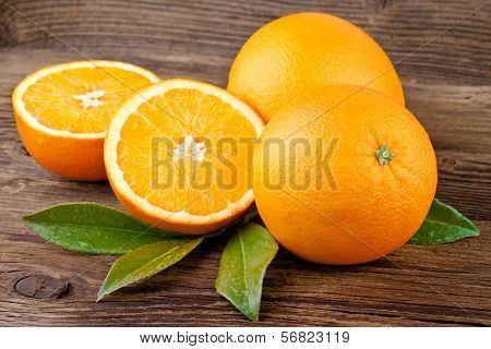 Oranges Fruit over Wooden background