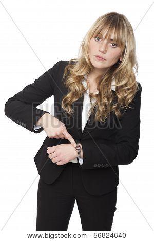 Businesswoman Pointing To Her Wristwatch