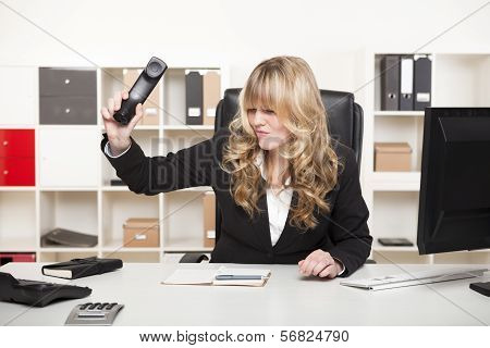 Businesswoman Slamming Down The Phone
