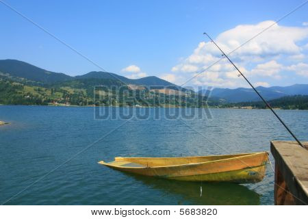 Lonely yellow fishing boat