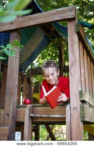 Boy in tree fort