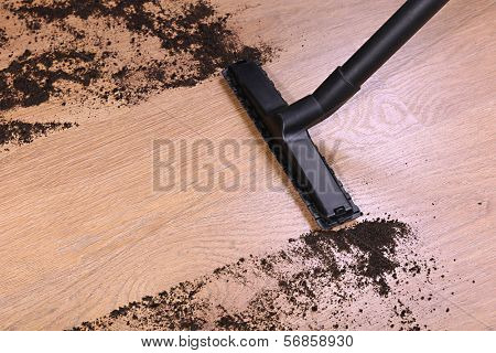 Vacuuming floor in house