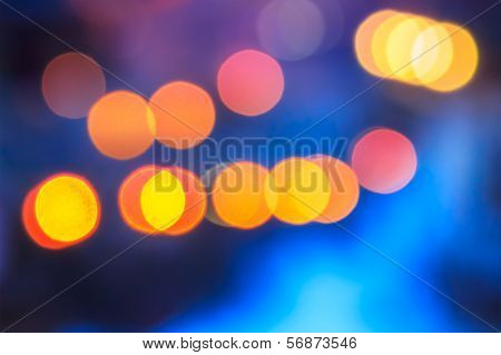 Abstract Background Of Blurred Lights With Bokeh Effect