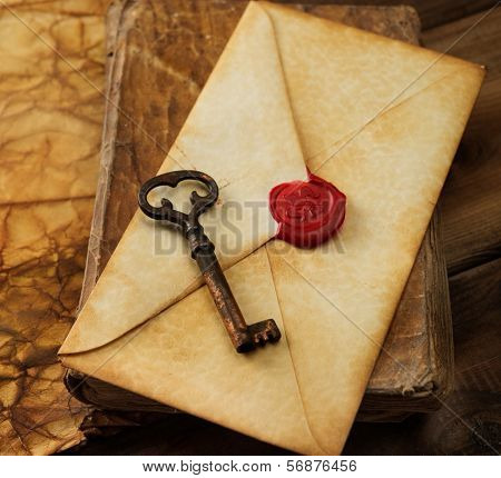 Book, old key and envelope on vintage blank paper