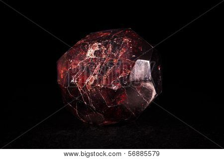 Garnet Mineral Stone In Front Of Black