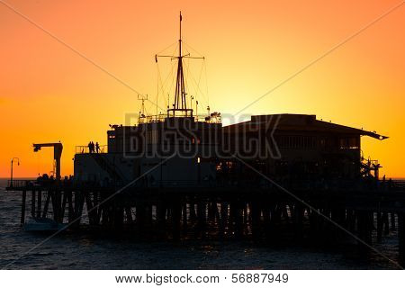 Silhouette of a pier in the ocean Santa Monica Pier Santa Monica Los Angeles County California USA poster