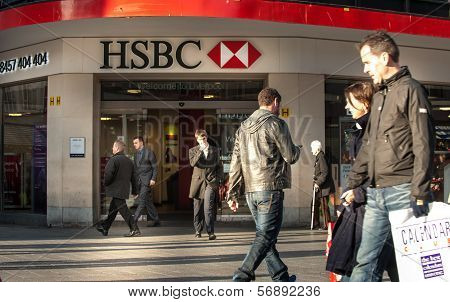 People walk past a HSBC bank branch in Liverpool, UK
