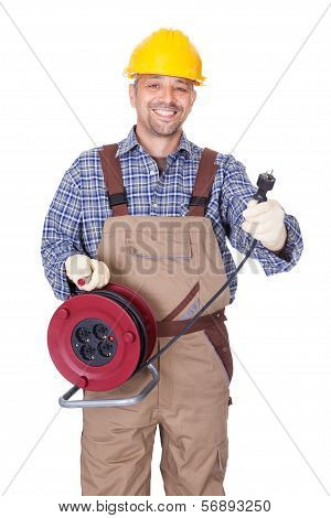 Happy Electrician Holding Wire Plug