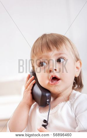Small Girl Listening To A Phone