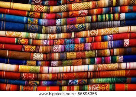 Colorful blankets for sale in the market in Otavalo Ecuador poster