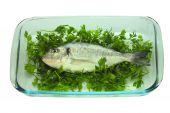 Fish on a plate. It is isolated on a white background poster