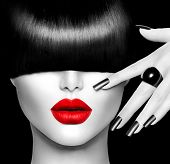 Black and White High Fashion Model Girl Portrait with Trendy Hair style, Make up and Manicure. Long Black Fringe Hairstyle, Black Matte Nail Polish and Red Lipstick. Woman Makeup. Sexy Lips. Haircut poster