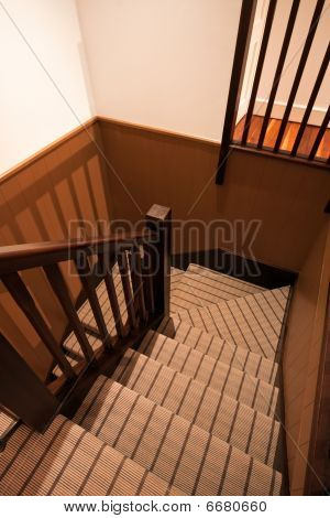 Carpeted U-shaped Staircase In A Luxury Home