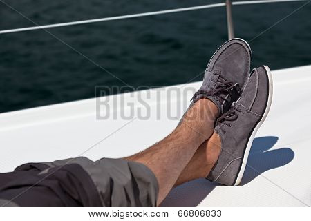 A Pair Of Hairy Man Legs In Pants And Topsiders
