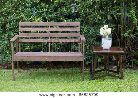 Wood Bench Decorated With White Roses