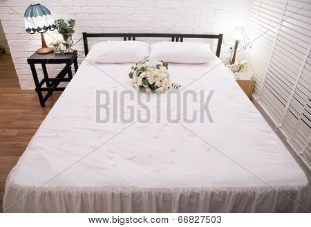 Honeymoon Bed Decorated With White Rose