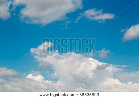 Fragmentary white clouds against the blue sky