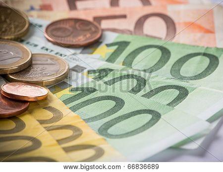 Euro coins and banknotes, macro photo.