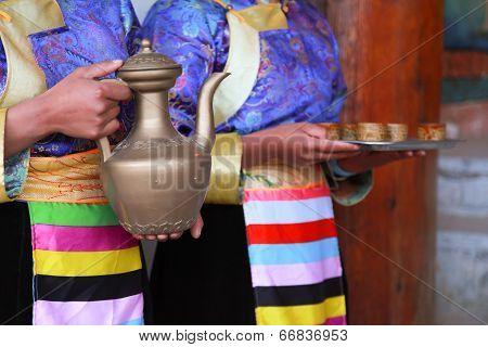 Tibetan Women Serving Traditional Style Milk Tea, Shangri-la, China