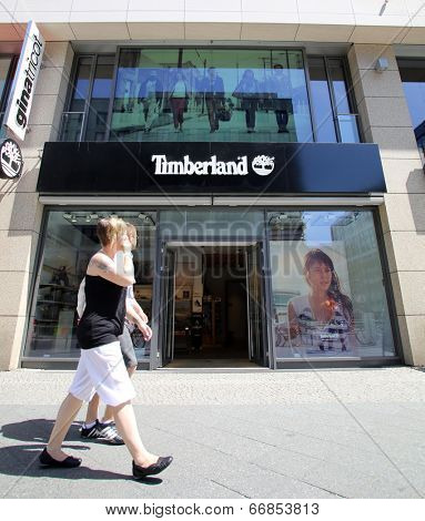 BERLIN, GERMANY - JUNE 11, 2014: Pedestrians walk past a Timberland LLC clothing and footware store in  Berlin, Germany, on Saturday, June 11, 2014