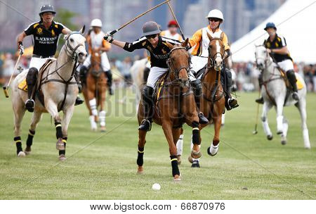 JERSEY CITY, NJ-MAY 31: Hilario Figueras (C) chases the ball during the polo match at the 7th Annual Veuve Cliquot Polo Classic at Liberty State Park on May 31, 2014 in Jersey City, NJ.