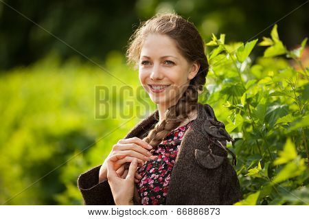 Beautiful Happy Young Woman With Pigtail