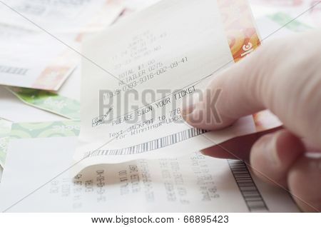 Coquitlam BC Canada - May 31, 2014 : Close up people holding a winning lottery ticket. The BC Lottery Corporation has provided government sanctioned lottery games in British Columbia since 1985.