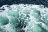 Patterns in Turquoise Sea Water created by a ship. poster