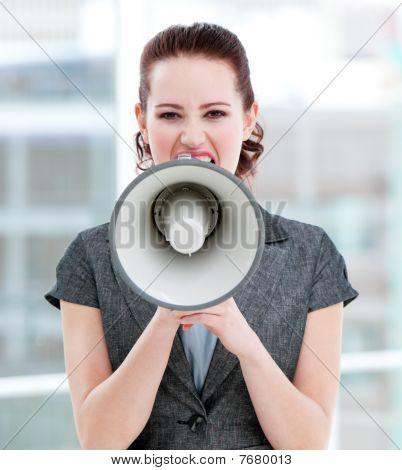 Furious Businesswoman Yelling Through A Megaphone
