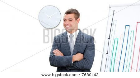 Young Businessman With Folded Arms Doing A Presentation