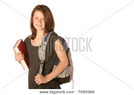 Teen carrying a book and backpack