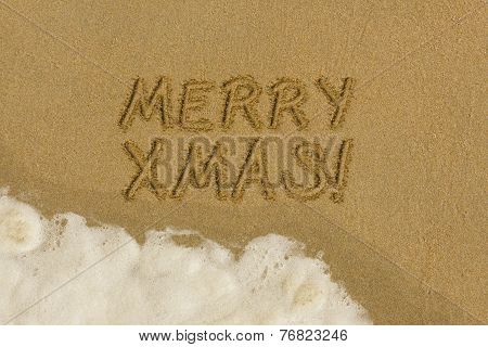 Merry Christmas message in the sand