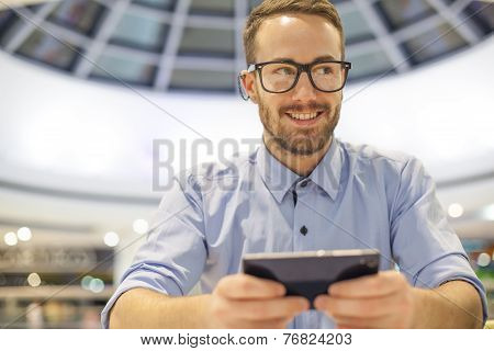 Young Businessman Seating On Table In Restoran And Use Mobile Device