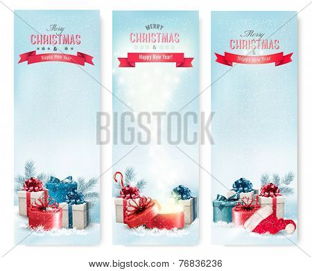 Three holiday Christmas banners with presents. Vector.