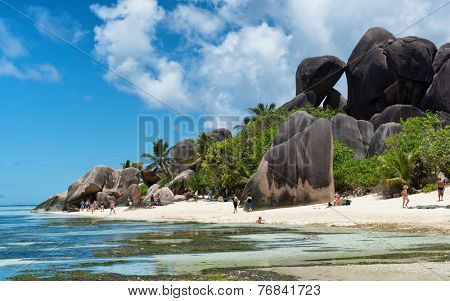 LA DIGUE, SEYCHELLES - 21 OCTOBER 2014 - Famous Huge Basaltic Rocks and Turquoise Lagoon at La Digue, Seychelles. Captured with Tourists Having Vacations on 21 October 2014.