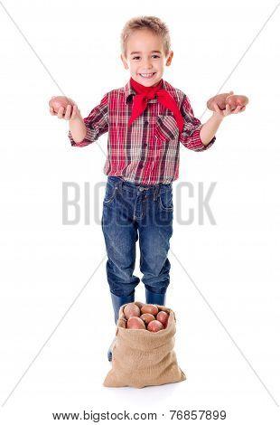 Happy Little Agriculturist Showing Potato Harvest
