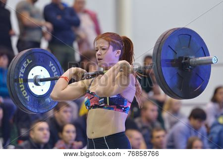 NOVOSIBIRSK, RUSSIA - NOVEMBER 16, 2014: Unidentified female athlete during the International crossfit competition Siberian Showdown. The competition is part of the festival Siberian Health.