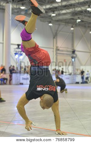 NOVOSIBIRSK, RUSSIA - NOVEMBER 16, 2014: Unidentified athlete during the International crossfit competition Siberian Showdown. The competition included in the program of the festival Siberian Health.