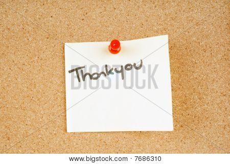 thankyou note pinned to a corkboard