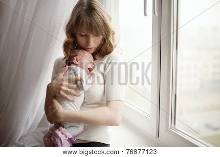 mother with cute little crying baby
