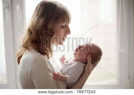 young mother with crying baby