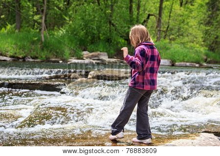 Young Girl Dipping Her Toe In The Water