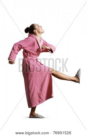 quarrelsome housewife giving kick, screaming and looking up. isolated on white background