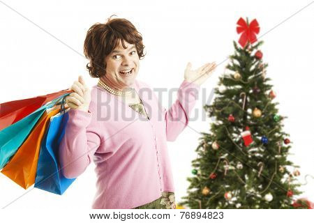 Man dressed as woman going on a Christmas shopping spree, holding bags.  Isolated on white.